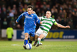 St Johnstone v Celtic...18.12.11   SPL .Kevin Moon tackled by Scott Brown.Picture by Graeme Hart..Copyright Perthshire Picture Agency.Tel: 01738 623350  Mobile: 07990 594431