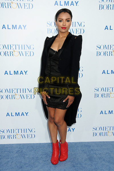 """KATERINA GRAHAM .""""Something Borrowed"""" Los Angeles Premiere held at Grauman's Chinese Theatre, Hollywood, California, USA, .3rd May 2011..full length black jacket dress ankle boots red pointy shoulders quilted shoulder pads wedges .CAP/ADM/BP.©Byron Purvis/AdMedia/Capital Pictures."""