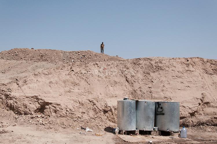 20/07/14  Iraq -- Daquq, Iraq -- Water tanks outside the peshmerga base in Daquq.