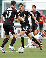 Pablo Hernandez #21 of D.C. United passes to Chris Pontius #13 during an MLS match against the Los Angeles Galaxy at RFK Stadium on July 18 2010, in Washington D.C. Galaxy won 2-1.