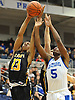 James Pryor #13 of St. Anthony's, left, and Cleevens Lans #5 of Kellenberg battle for a rebound during the NSCHSAA varsity boys basketball final at Hofstra University on Tuesday, Mar. 1, 2016. St. Anthony's won by a score of 49-45.