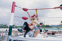 Diabolica gets her opponent against the ropes in a dramatic leg hold.  Luchadoras in Ecatepec, Estado de Mexico. June, 2004