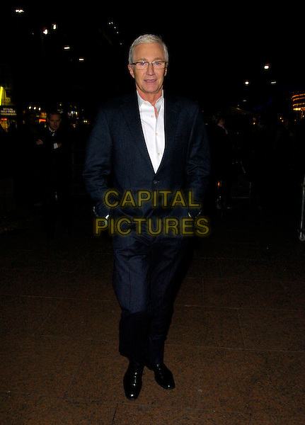 "PAUL O'GRADY.The UK Film Premiere of ""St. Trinian's"" held at the Empire Leicester Square, London, England..December 10th 2007.full length black pinstripe suit hands in pockets glasses.CAP/CAN.©Can Nguyen/Capital Pictures"