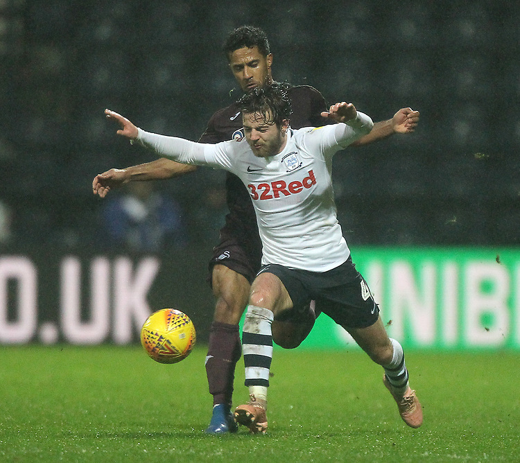 Preston North End's Ben Pearson battles with  Swansea City's Wayne Routledge<br /> <br /> Photographer Mick Walker/CameraSport<br /> <br /> The EFL Sky Bet Championship - Preston North End v Swansea City - Saturday 12th January 2019 - Deepdale Stadium - Preston<br /> <br /> World Copyright &copy; 2019 CameraSport. All rights reserved. 43 Linden Ave. Countesthorpe. Leicester. England. LE8 5PG - Tel: +44 (0) 116 277 4147 - admin@camerasport.com - www.camerasport.com