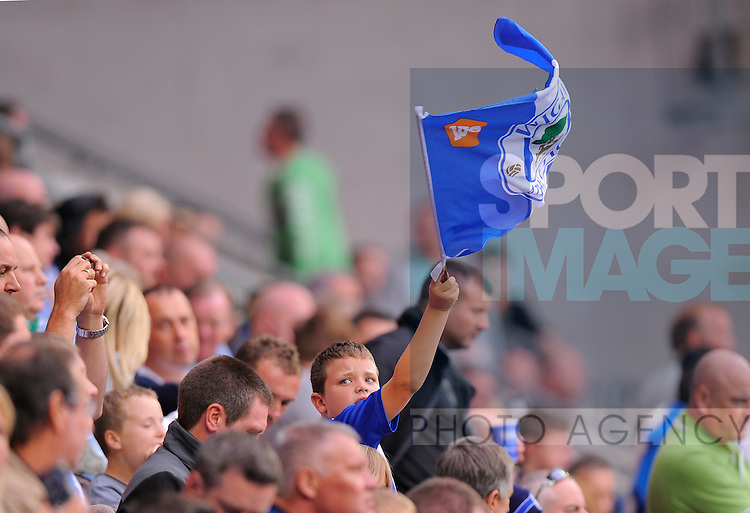 A young Wigan fan flies the club flag