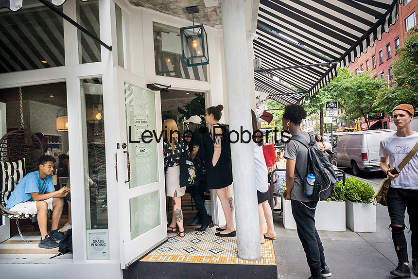Millennials crowd the popular By Chloe vegan fast casual dining restaurant on Bleecker Street in Greenwich Village in New York Thursday, June 23, 2016. The restaurant, created by Chloe Coscarelli, is opening an outpost in the Flatiron District in New York. She is a partner with Samantha Wasser of ESquared Hospitality which perversely owns the BLT Steak franchise. (© Richard B. Levine)