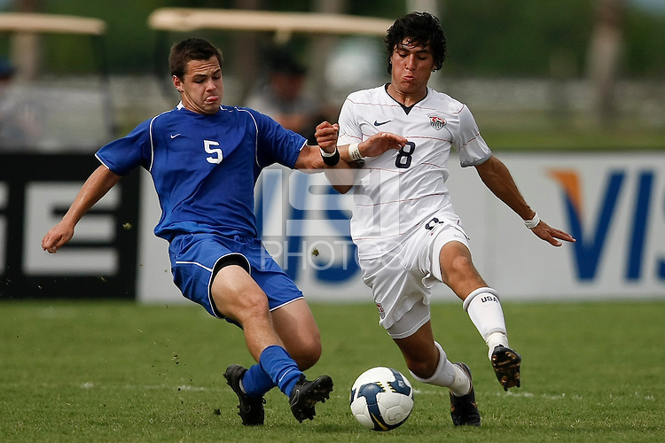 Frank Saunders (5) of the Academy Select Team and Carlos Martinez (8) of the USA. The US U-17 Men's National Team defeated the Development Academy Select Team 5-3 during day two of the US Soccer Development Academy  Spring Showcase in Sarasota, FL, on May 23, 2009.