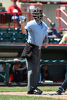 Home plate umpire Blake Felix makes a call during a game between the Akron RubberDucks and Erie SeaWolves on May 18, 2014 at Jerry Uht Park in Erie, Pennsylvania.  Akron defeated Erie 2-1.  (Mike Janes/Four Seam Images)