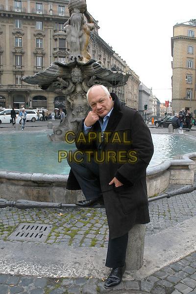 "ERIC EMMANUEL SCHMITT.Photocall for the film ""Lezioni di felicit"", Rome, Italy..February 25th, 2008.full length black coat fountain.CAP/CAV.©Luca Cavallari/Capital Pictures."