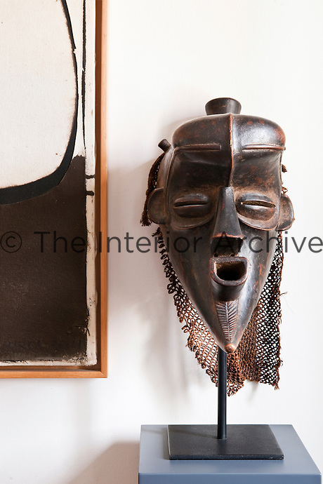 Close up of ' Ba - Bindji' one of the Congo masks collected by the owner displayed on a stand