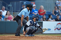 Scranton/Wilkes-Barre RailRiders catcher Kyle Higashioka (66) sets a target as home plate umpire Charlie Ramos looks on during the game against the Gwinnett Stripers at BB&T BallPark on August 16, 2019 in Lawrenceville, Georgia. The Stripers defeated the RailRiders 5-2. (Brian Westerholt/Four Seam Images)
