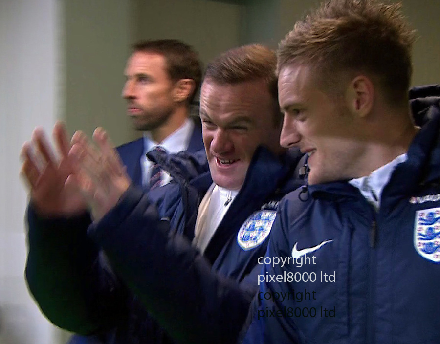 Pic shows:<br /> Slovenia v England<br /> Dropped captain Wayne Rooney in the tunnel made a circle with his fingers almost like he wanted to strangle someone - Manager Gareth Southgate did not seem as amused as  Jamie Vardy.<br /> <br /> <br /> Picture by Pixel8000 07917221968