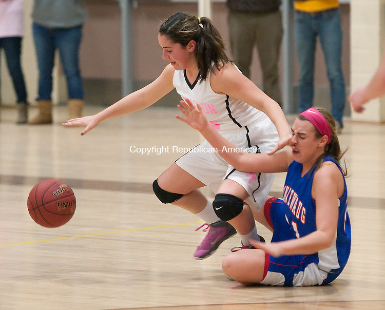 THOMASTON, CT-021514JS11- Nonnewaug's Erin South (21) takes a shot to the face while trying to steal the ball from Thomaston's (23) Sarah Guay (23) during their game Monday at Thomaston High School.<br /> Jim Shannon Republican-American