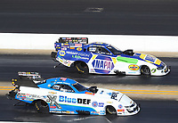 Oct 14, 2019; Concord, NC, USA; NHRA funny car driver John Force (near) alongside Ron Capps during the Carolina Nationals at zMax Dragway. Mandatory Credit: Mark J. Rebilas-USA TODAY Sports