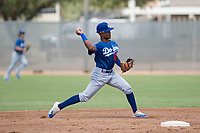 Los Angeles Dodgers shortstop Eddys Leonard (84) throws to first base during an Instructional League game against the Milwaukee Brewers at Maryvale Baseball Park on September 24, 2018 in Phoenix, Arizona. (Zachary Lucy/Four Seam Images)