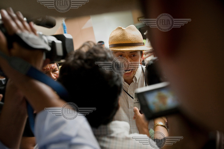 Pablo Fajardo talks to the press after handing in court papers to the Superior Court of Justice as part of legal proceedings suing for damaging the image of the Cofanes, an indigenous group, who have suffered from the pollution resulting from Texaco's operations in the region. A class action lawsuit was brought against US multinational oil giant Texaco (acquired by Chevron in 2001) by more than 30,000 Ecuadorians. The case has been in the Ecuadorian courts since 2003 and relates to the dumping of billions of gallons of toxic materials into unlined pits and Amazonian rivers. In February 2011 the court ruled that Chevron should pay a fine totalling 9.5 billion USD. However, Chevron has stated that the ruling is 'illegitimate and unenforceable' and has started numerous counter proceedings in US courts. There is some doubt as to whether it will be possible to force Texaco to pay the fine.