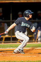 Dario Pizzano #59 of the Pulaski Mariners follows through on his swing against the Bluefield Blue Jays at Bowen Field on July 1, 2012 in Bluefield, West Virginia.  The Mariners defeated the Blue Jays 4-3.  (Brian Westerholt/Four Seam Images)