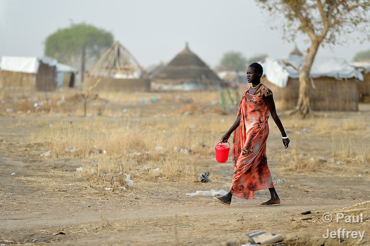 A displaced woman walks in Agok, a town in the contested Abyei region where tens of thousands of people fled in 2011 after an attack by soldiers and militias from the northern Republic of Sudan on most parts of Abyei. Although the 2005 Comprehensive Peace Agreement called for residents of Abyei--which sits on the border between Sudan and South Sudan--to hold a referendum on whether they wanted to align with the north or the newly independent South Sudan, the government in Khartoum and northern-backed Misseriya nomads, excluded from voting as they only live part of the year in Abyei, blocked the vote and attacked the majority Dinka Ngok population. The African Union has proposed a new peace plan, including a referendum to be held in October 2013, but it has been rejected by the Misseriya and Khartoum.