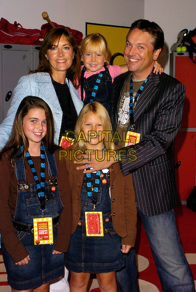 "BRIAN CONLEY & FAMILY.""High School Musical"" UK Premiere, Empire Cinema, London, UK..September 10th, 2006.Ref: CAN.half length pinstripe kids children uniform brown suit jacket jeans denim.www.capitalpictures.com.sales@capitalpictures.com.©Can Nguyen/Capital Pictures"