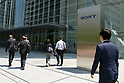 Pedestrians walk past a Sony signboard on display outside company's headquarters on May 23, 2017, Tokyo, Japan. Kazuo Hirai, President and Chief Executive Officer of Sony Corp. announced Sony's midterm financial targets for the current fiscal year ending March 31, 2018. (Photo by Rodrigo Reyes Marin/AFLO)
