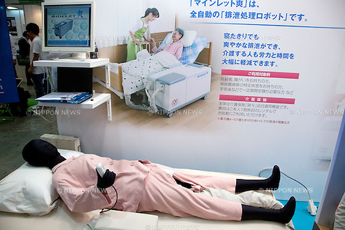 October 17, 2012, Tokyo, Japan - A dummy holds a remote control of the new hospital prototype bed at Japan Robot Week. The Japan Robot Week 2012 shows the New Energy and Industrial Robot Innovation Technology products in Japan, the exhibition opens from October 17 to 19 at Tokyo Big Sight. (Photo by Rodrigo Reyes Marin/AFLO)..
