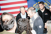Ohio governor and Republican presidential candidate John Kasich greets people after a town hall campaign event at Raymond VFW Post 4479 in Raymond, New Hampshire, on Wed., Feb. 3, 2016.