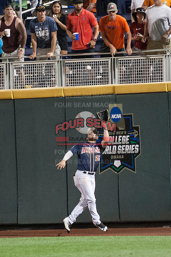 Arizona Wildcats outfielder Zach Gibbons (23) makes a running catch against the Oklahoma State Cowboys in Game 6 of the NCAA College World Series on June 20, 2016 at TD Ameritrade Park in Omaha, Nebraska. Oklahoma State defeated Arizona 1-0. (Andrew Woolley/Four Seam Images)