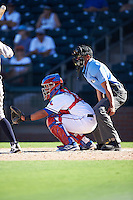 Surprise Saguaros catcher Jose Trevino (13), of the Texas Rangers organization, and home plate umpire Roberto Ortiz during a game against the Salt River Rafters on October 17, 2016 at Surprise Stadium in Surprise, Arizona.  Surprise defeated Salt River 3-1.  (Mike Janes/Four Seam Images)