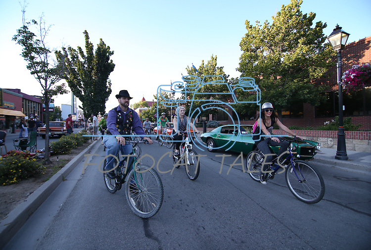 Riders cruise through downtown during the first annual Blinky Man event in Carson City, Nev., on Wednesday, June 19, 2013.<br /> Photo by Cathleen Allison
