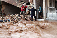 Pictured: Local people tend to their properties.<br /> Re: Five people have reportedly died and severe damage caused by heavy rain and flash flooding in the area of Mandra, near Athens, Greece. Wednesday 15 November 2017