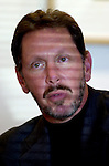 Oracle Corp. CEO Larry Ellison listens to a question about new e-business application strategies during a press briefing at Oracle headquarters Monday, April 23, 2001, in Redwood City, Calif. Oracle will unveil on Tuesday a new guarantee to install a key piece of e-business software in 90 days to customers. (AP Photo/Paul Sakuma)