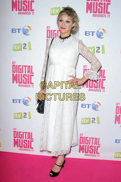 Nikki Grahame.BT Digital Music Awards held at the Roundhouse, Chalk Farm, London, England..September 29th 2011.full length white dress lace sleeves black peep toe shoes ankle strap hand on hip.CAP/CJ.©Chris Joseph/Capital Pictures.