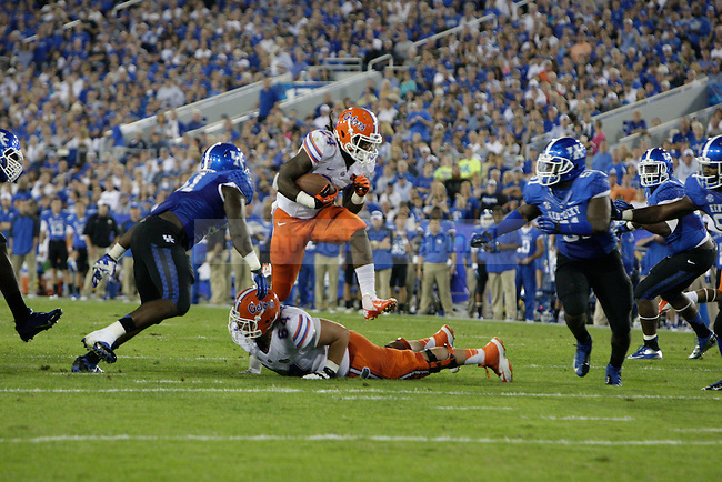 Florida Gators running back Matt Jones (24) leaps over his own teammate during his run during the first half of the UK Football game against Florida at Commonwealth Stadium in Lexington, Ky., on Saturday, September, 28, 2013. Photo by Jonathan Krueger | Staff