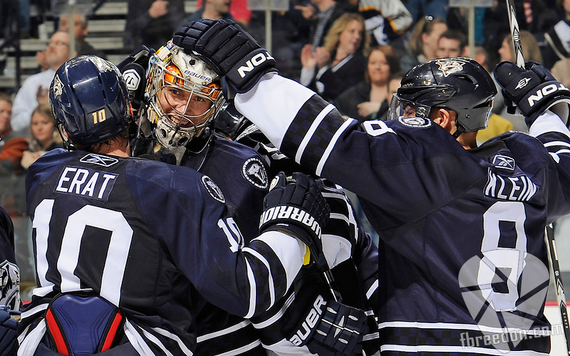 NASHVILLE, TN - MARCH 12:  Jordin Tootoo #22, Martin Erat #10, and Kevin Klein #8 of the Nashville Predators congratulate teammate goalie Pekka Rinne after defeating the Colorado Avalanche on March 12, 2011 at the Bridgestone Arena in Nashville, Tennessee.  (Photo by Frederick Breedon/Getty Images) *** Local Caption *** Jordin Tootoo; Kevin Klein; Pekka Rinne; Martin Erat
