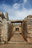 Low angle view of a passageway in the Mnajdra Temple complex, c.3600-3200 BC, Malta, pictured on June 5, 2008, in the morning. The Republic of Malta consists of seven islands in the Mediterranean Sea of which Malta, Gozo and Comino have been inhabited since c.5,200 BC. It has been ruled by Phoenicians (Malat is Punic for safe haven), Greeks, Romans, Fatimids, Sicilians, Knights of St John, French and the British, from whom it became independent in 1964. Nine of Malta's important historical monuments are UNESCO World Heritage Sites, including  the well preserved Mnajdra Temple complex. Spectacularly sited on the Southern coast of Malta the three temples radiate from an oval forecourt. The lower temple is astronomically aligned so that the sun's rays shine straight through the doorway on the equinoxes. Picture by Manuel Cohen.