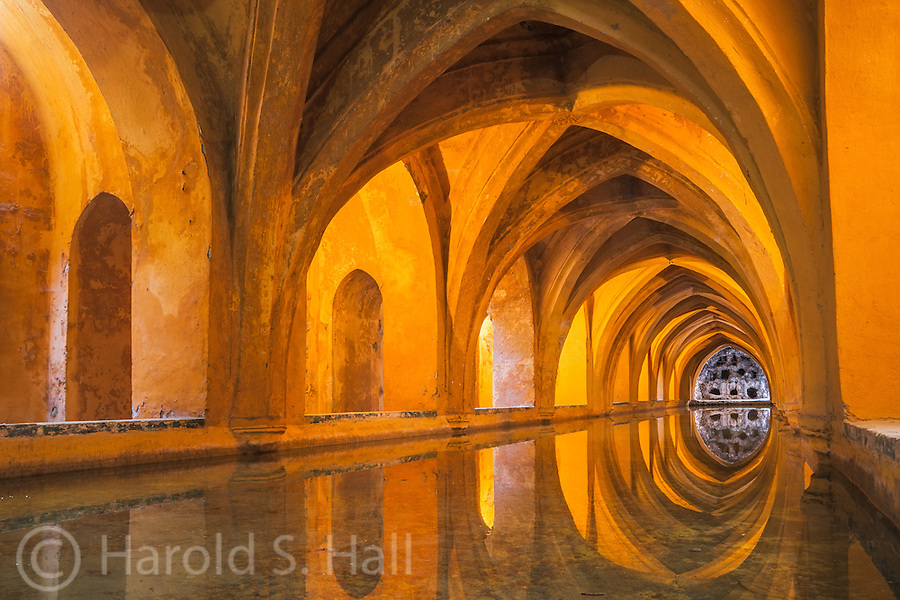 The Real Alcázar of Seville, Spain is a royal palace built originally for Moorish Kings.  Unlike the possibly more famous Alhambra of Grenada which was looted, occupied by squatters, the upper levels of the Alcázar are still used by the royal family as the official Seville residence.  This is the bath house of the Moorish Kings.