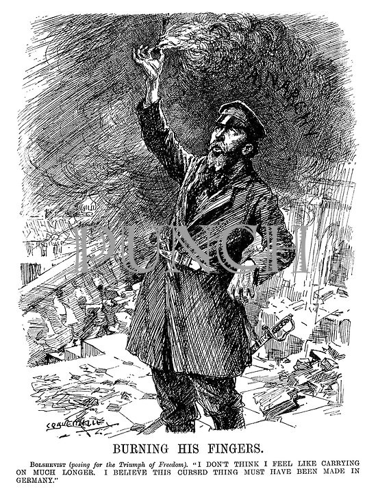 """Burning His Fingers. Bolshevist (posing for the Triumph of Freedom). """"I don't think I feel like carrying on much longer. I believe this cursed thing must have been made in Germany."""" (a Bolshevik stands with a touch paper burning the flames of Anarchy during WW1)"""
