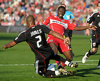 DC United defender Julius James (2) and Chicago Fire forward Patrick Nyarko (14) slide for the ball.  The Chicago Fire tied DC United 0-0 at Toyota Park in Bridgeview, IL on Oct. 16, 2010.