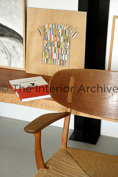 In the living room is one of a pair of Hans Wegner armchairs and a woodcut by Jean-Loup Lafont