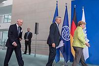 Gemeinsame Presseunterrichtung nach dem Gespraech von Bundeskanzlerin Merkel mit dem Hohen Fluechtlingskommissar der Vereinten Nationen (UNHCR), Filippo Grandi (mitte), und dem Generaldirektor der Internationalen Organisation fuer Migration (IOM), William Lacy Swing (links) am Freitag den 11. August 2017 im Bundeskanzleramt.<br /> 11.8.2017, Berlin<br /> Copyright: Christian-Ditsch.de<br /> [Inhaltsveraendernde Manipulation des Fotos nur nach ausdruecklicher Genehmigung des Fotografen. Vereinbarungen ueber Abtretung von Persoenlichkeitsrechten/Model Release der abgebildeten Person/Personen liegen nicht vor. NO MODEL RELEASE! Nur fuer Redaktionelle Zwecke. Don't publish without copyright Christian-Ditsch.de, Veroeffentlichung nur mit Fotografennennung, sowie gegen Honorar, MwSt. und Beleg. Konto: I N G - D i B a, IBAN DE58500105175400192269, BIC INGDDEFFXXX, Kontakt: post@christian-ditsch.de<br /> Bei der Bearbeitung der Dateiinformationen darf die Urheberkennzeichnung in den EXIF- und  IPTC-Daten nicht entfernt werden, diese sind in digitalen Medien nach §95c UrhG rechtlich geschuetzt. Der Urhebervermerk wird gemaess §13 UrhG verlangt.]