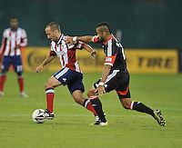 Chivas USA midfielder Peter Vagenas (6) goes against D.C. United forward Maicon Santos (29) D.C. United defeated Chivas USA 1-0 at RFK Stadium, Sunday September 23, 2012.
