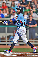 Tennessee Smokies right fielder Rubi Silva #24 swings at a pitch during a game against the Birmingham Barons at Smokies Park on May 31, 2014 in Kodak, Tennessee. The Barons defeated the Smokies 2-1. (Tony Farlow/Four Seam Images)