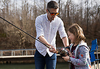 NWA Democrat-Gazette/CHARLIE KAIJO Alivia Steeves, 8 and David Steeves of Centerton (from right) fish, Sunday, January 6, 2019 at Lake Atalanta in Rogers.