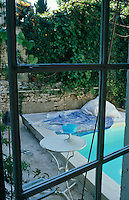 Glimpse from an upstairs window over the plunge pool in the courtyard garden