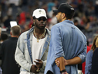 Rio Ferdinand an English former professional footballer seen on the sidelines with British born Miami Dolphins running back Jay Ajayi, prior to the kick off at the Super Bowl LI, NRG Stadium, Houston, Texas, USA