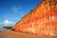Colorful cliffs and palm trees at Barra do Cahy beach, where the Brazilian Indians and the Portuguese colonizers first met in 1500 at Cumuruxatiba, Bahia State, northeast Brazil.