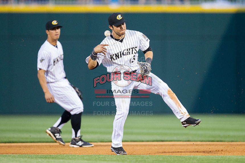 Charlotte Knights second baseman Carlos Sanchez (13) can't handle a ground ball during the game against the Lehigh Valley IronPigs at BB&T Ballpark on May 8, 2014 in Charlotte, North Carolina.  The IronPigs defeated the Knights 8-6.  (Brian Westerholt/Four Seam Images)