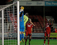 Crawley Town's Glenn Morris clears under pressure from Exeter City's David Wheeler during the Sky Bet League 2 match between Crawley Town and Exeter City at Broadfield Stadium, Crawley, England on 28 February 2017. Photo by Carlton Myrie / PRiME Media Images.