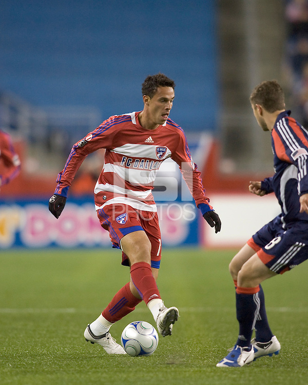FC Dallas midfielder Andre Rocha (11) brings the ball forward as New England Revolution midfielder Chris Tierney (8) defends. The New England Revolution defeated FC Dallas, 2-1, at Gillette Stadium on April 4, 2009. Photo by Andrew Katsampes /isiphotos.com