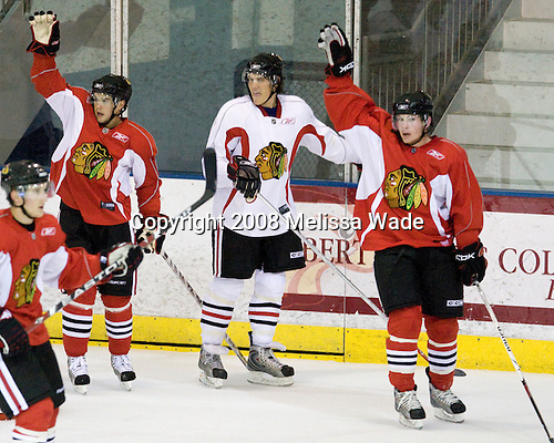 (Sweatt) Dan Bertram (Red 14), ?, Ben Smith (Red 56) - Prospects and free agents took part in the 2008 Chicago Blackhawks Prospects Camp at Edge Ice Arena in Bensenville, Illinois, on Thursday, July 10, 2008.